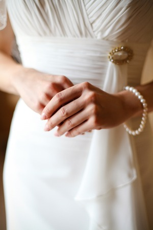 The bride in a white dress, hand and fingers 1 Stock Photo