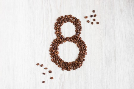 table grain: Grain coffee as eight on the womens day are on the table Stock Photo