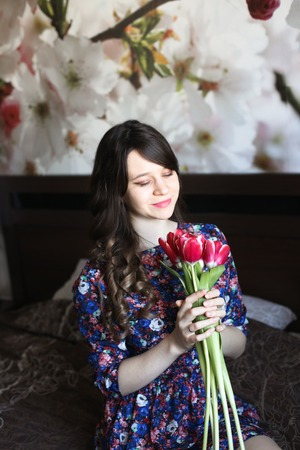 red bathrobe: Girl with red flowers in the bed