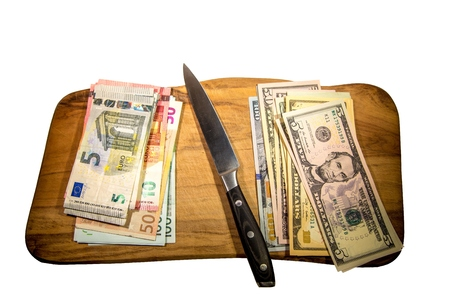 two us dollar: Two leading hard currencies - US Dollar versus Euro on a cutting board