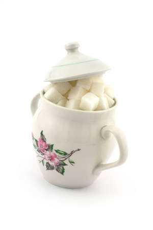 Isolated photo of sugar bowl filled with lump sugar