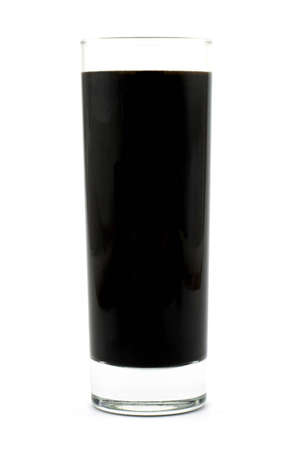 Isolated photo of glass of black liquid