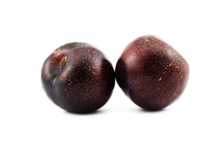 Isolated photo of two big fresh plums Stock Photo