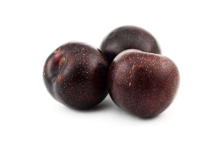 Isolated photo of three fresh big plums