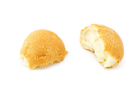 Isolated photo of a broken bun with sesame Stock Photo