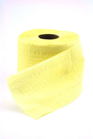 Isolated photo of roll of yellow toilet paper