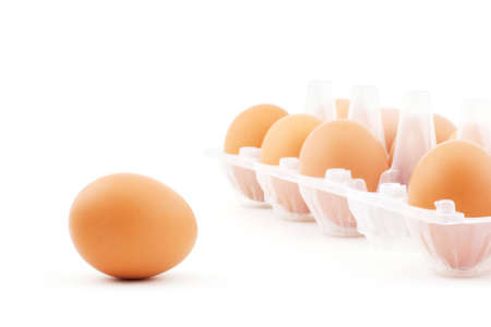 Isolated photo of some eggs in the white box and single egg