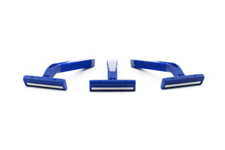 Isolated photo of several blue plastic razors
