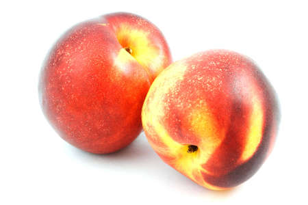 Isolated photo of two big fresh nectarines