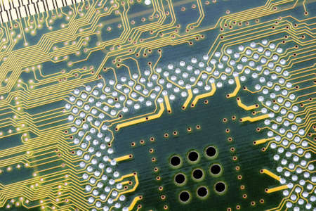 An photo of the back side of yellow computer mother board. Stock Photo