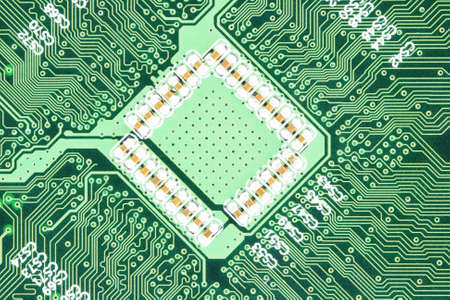 An photo of the back side of green computer mother board.