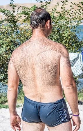 Hairy Man On Beach