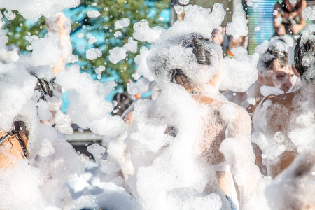 People in foam at a foam party Banque d'images