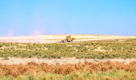 Tractor plows the steppe Stock Photo