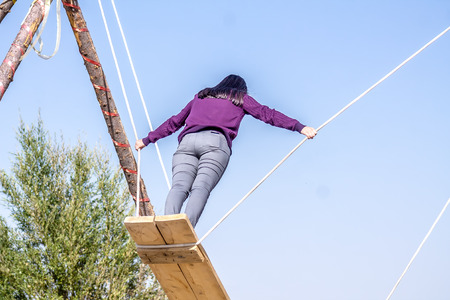 Young girl with long hair on a swing Stock Photo