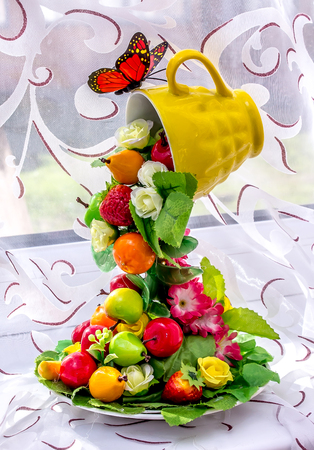 Bright autumn fruits from a cup of installation Stock Photo