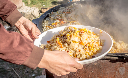 Preparation of pilaf in the fresh air Stock Photo