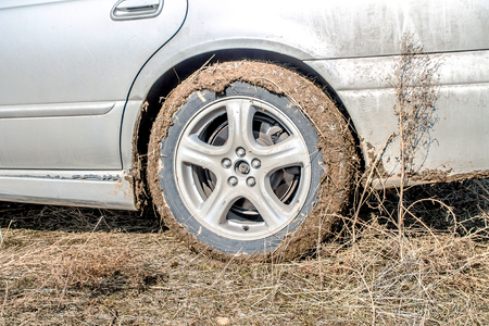 Wheel of a car in the mud Stock Photo