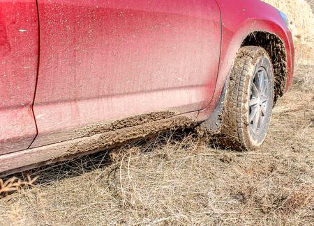 Wheel of a car in the mud Banco de Imagens