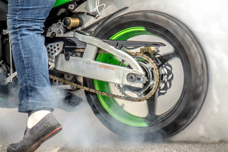 Smoke from under the wheels of a motorcycle with the drift Moto Drift