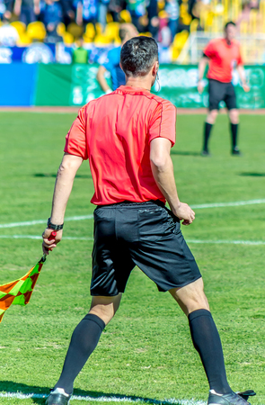 Shymkent, Kazakhstan, March 17, 2018; Football match at the stadium.Champion of the Republic of Kazakhstan between the teams Ordabasy Shymkent - Kyzyl Zhar Petropavlovsk. A side judge with a flag.