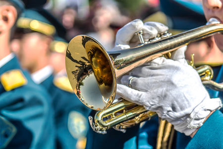 A military brass band-Man plays the trumpet Stock Photo