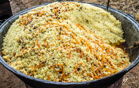 Preparation of pilaf in the open air Stock Photo