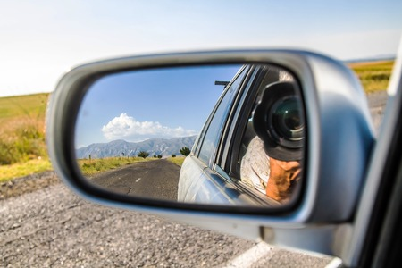 Landscape reflection in car rearview mirror in Arizona