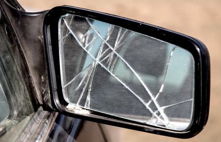 Broken side mirror of a car closeup