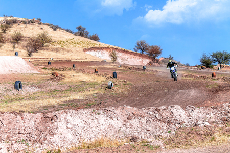 Motocross track landscape with a rider trying the track Imagens