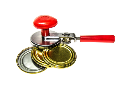 Tin can opener with tin can lids Stock Photo