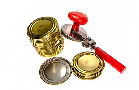 Tin can opener and tin cans Stock Photo