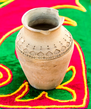Handmade large earthenware jar with national Kazakh patterns
