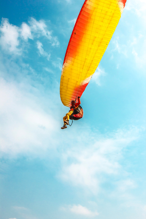 Paraglider in the air against the sky 스톡 콘텐츠