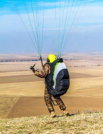 Paraglider on a paraglider in the air Standard-Bild