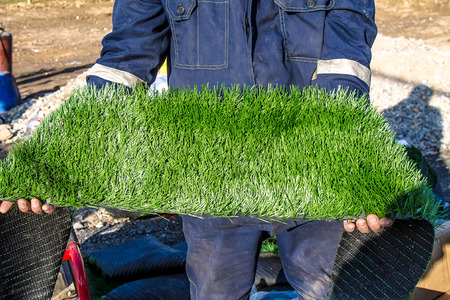 Green artificial grass in a roll