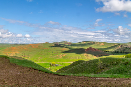 Green hills in the foothills in the spring landscape