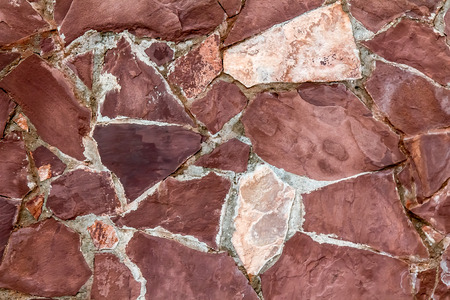 Wall of natural stone as background