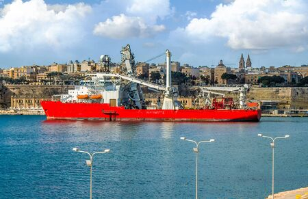 Large cargo ship for underwater work in the port of Malta
