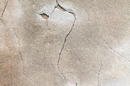 Plastered gray concrete wall as background