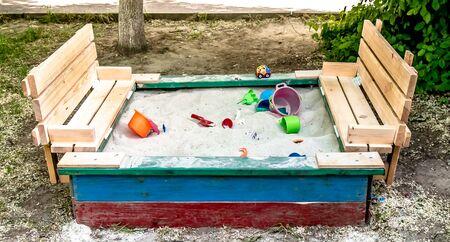 Multi-colored wooden box for sand children's sandbox