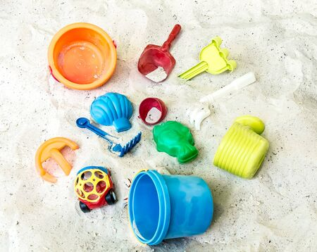 Children's colored plastic toys in the sandbox Standard-Bild