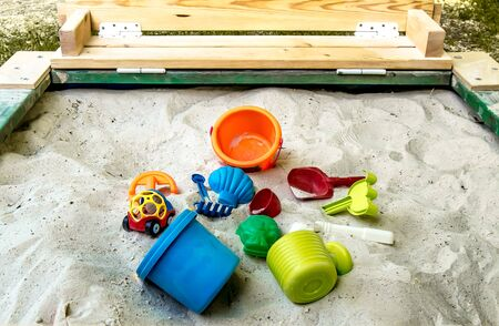 Children's colored plastic toys in the sandbox
