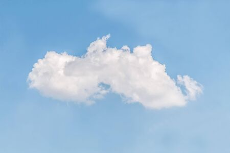 White cloud against blue sky as background