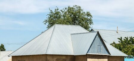 The roof of the house from galvanized metal profile against the sky