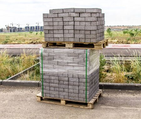 Paving slabs on pallets. The concept of new construction