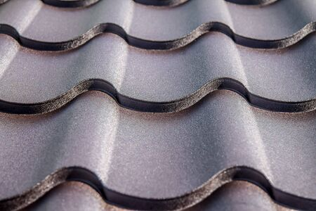 Metal profile to cover the roof of the house close-up as a background