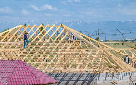 Building a roof on a sunny day. The concept of building new housing.