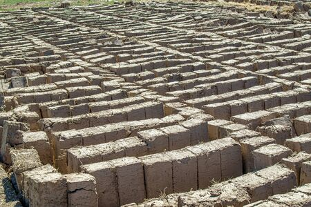 Adobe brick from adobe for construction. The concept of the construction of housing from clay.