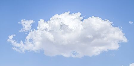 White cloud on a blue sky as a background, screensavers on a computer, creativity for design.